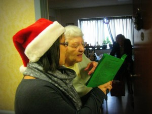 Student and nursing home resident singing Christmas carols