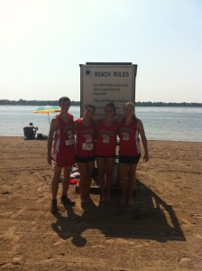 The D'Youville cross-country team enjoying the beach at Beaver Island on a hot day after their race
