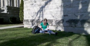 student studying outside on the grass