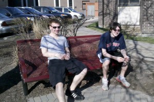 students sitting on bench outside