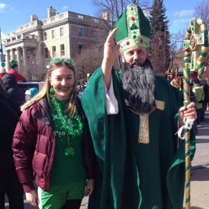 student with St. Patrick at parade