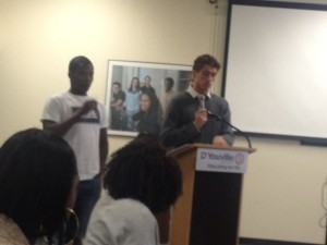 Male student speaking at summit