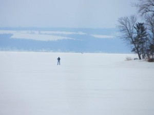 Someone ice fishing on the great lakes.