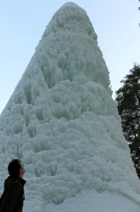 Over 50 feet of frozen ice created by a geyser in a pond near the Glen Iris Inn.