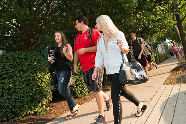 freshman students walking on D'Youville campus
